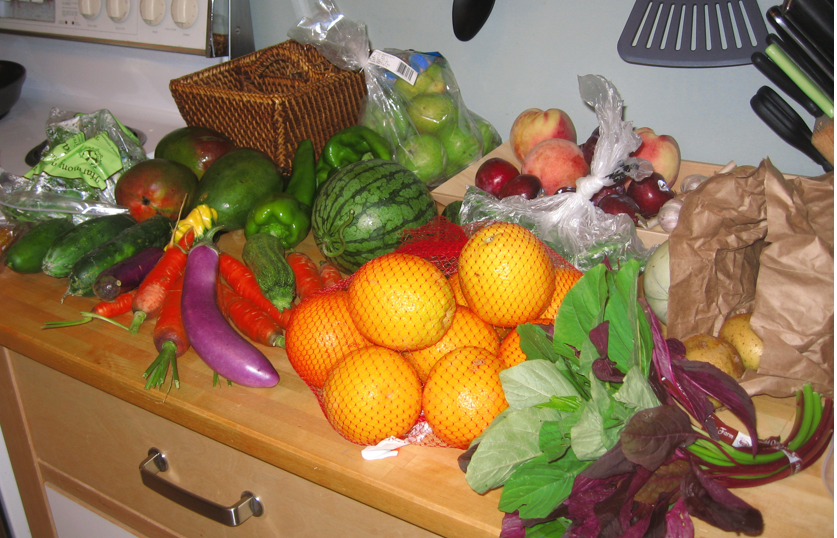 Our kitchen counter, covered with this week's farmshare bounty