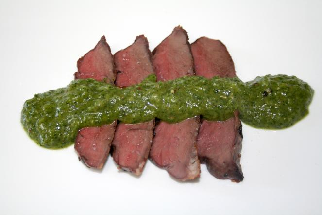 Grilled venison heart with stinging nettle chimichurri