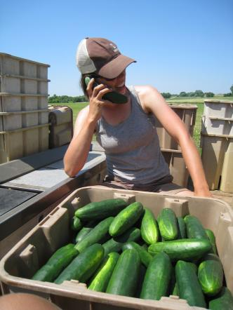 """Molly talking on her cucumber """"phone"""""""