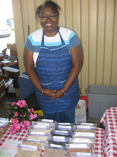 Mary Hall, selling her locally grown Southern style beans at the Market