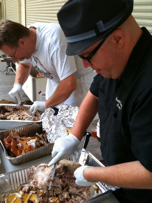 Don and Dave pulling the pig