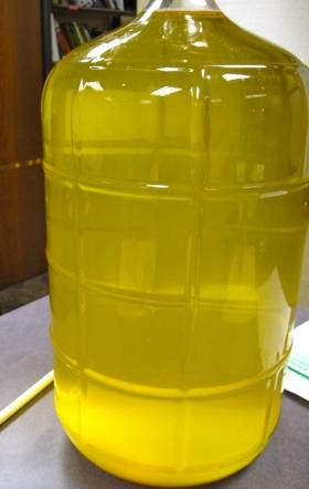 The racked wine. The debris on the bottom is the lees - particles and yeast cells.